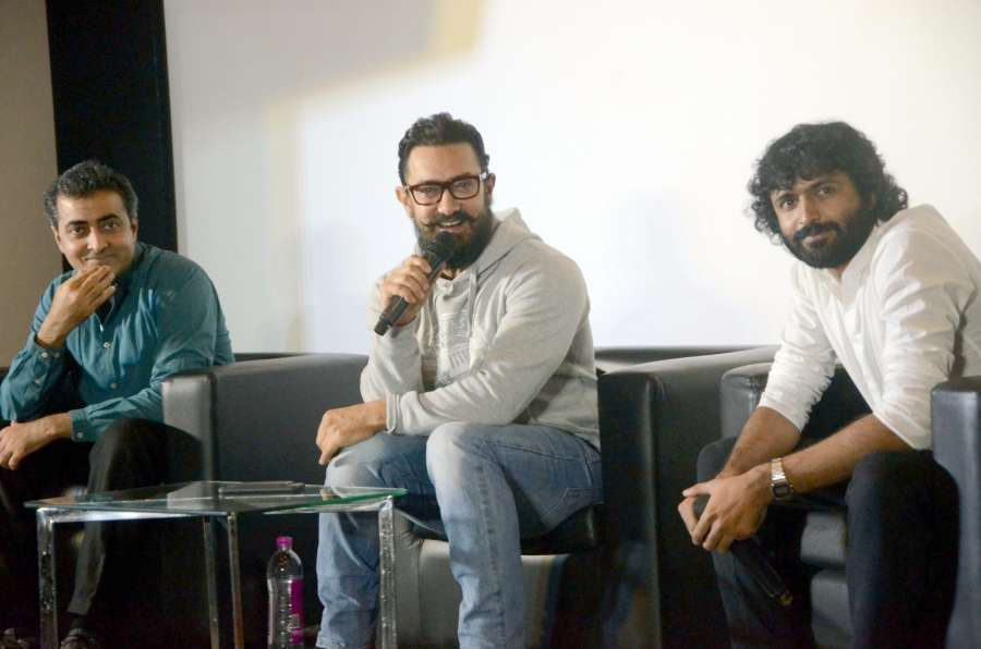 Mumbai: Actor Aamir Khan and directors Advit Chandan and Akash Chawla during the trailer launch of film Secret Superstar in Mumbai, on Dec 16, 2016. (Photo: IANS)