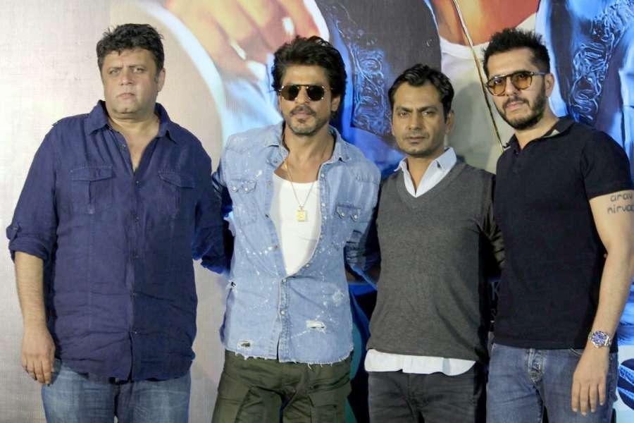 Mumbai: Actors Shahrukh Khan, Nawazuddin Siddiqui and Filmmakers Rahul Dholakia, Ritesh Sidhwani during the trailer launch of film Raees in Mumbai on Dec 7, 2016. (Photo: IANS)