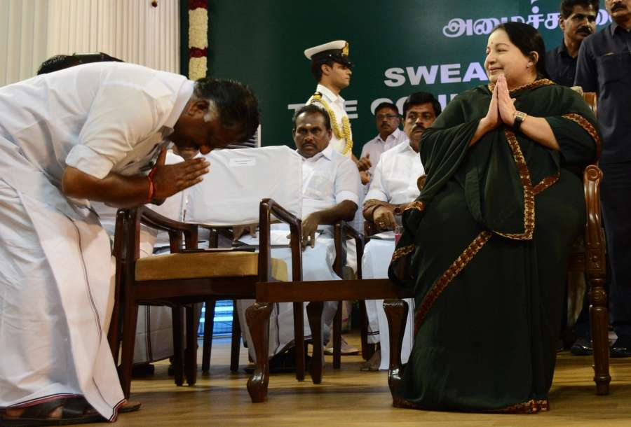 FILE PHOTO: AIADMK leader O Panneerselvam bows down before AIADMK general secretary J Jayalalithaa during her swearing in ceremony as Tamil Nadu chief minister at Madras University in Chennai, on May 23, 2016. (File Photo: IANS)