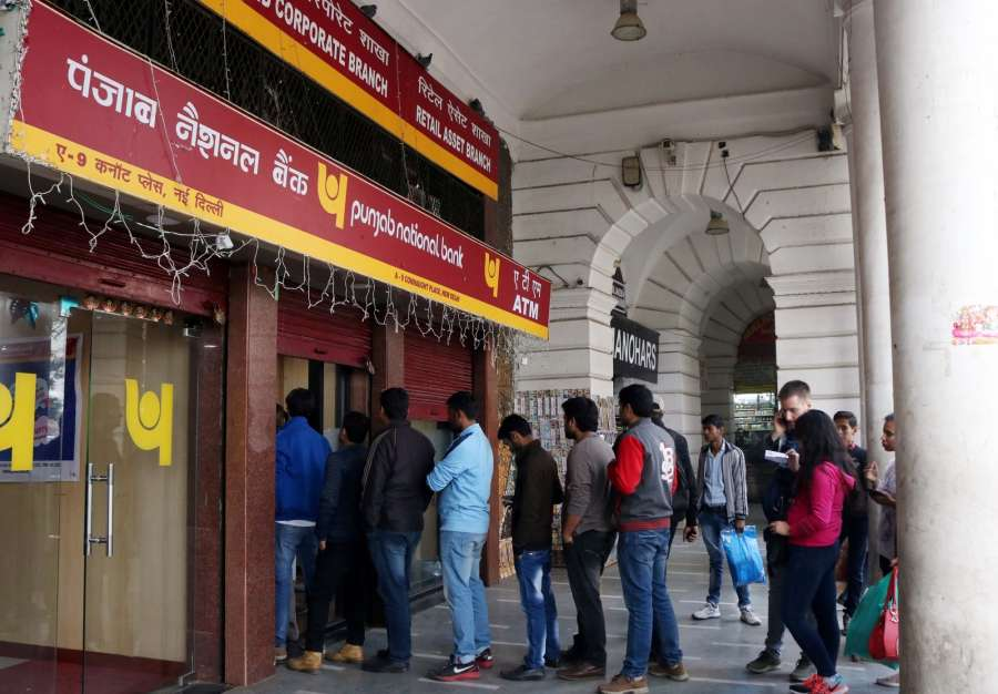 New Delhi: People queue up outside an ATM kiosk to withdraw cash on the last day of demonetisation in New Delhi on Dec 30, 2016. (Photo: IANS)