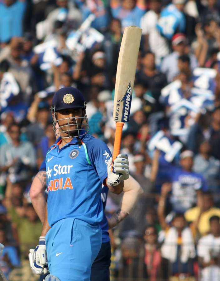 Cuttack: MS Dhoni of India raises his bat to celebrate his half-century during the Second One Day International cricket match between India and England at Barabati Stadium in Cuttack on Jan 19, 2017. (Photo: Surjeet Yadav/IANS) by .
