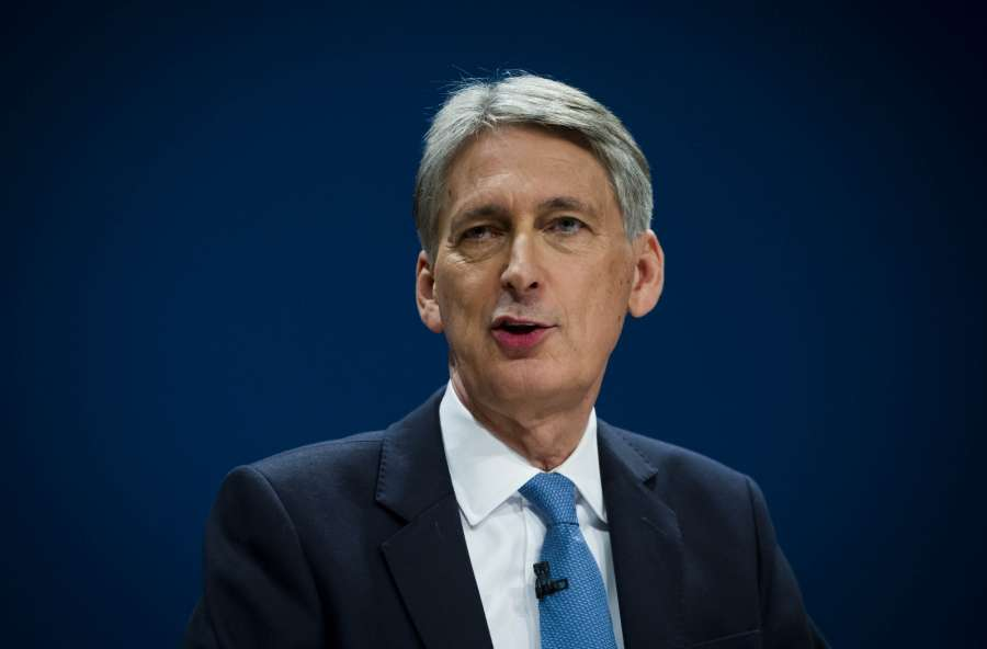 BIRMINGHAM, Oct. 3, 2016 (Xinhua) -- British Chancellor of the Exchequer Philip Hammond delivering a speech on Day Two of the Conservative Party Conference in Birmingham, England, on Oct. 3, 2016. (Xinhua/IANS)