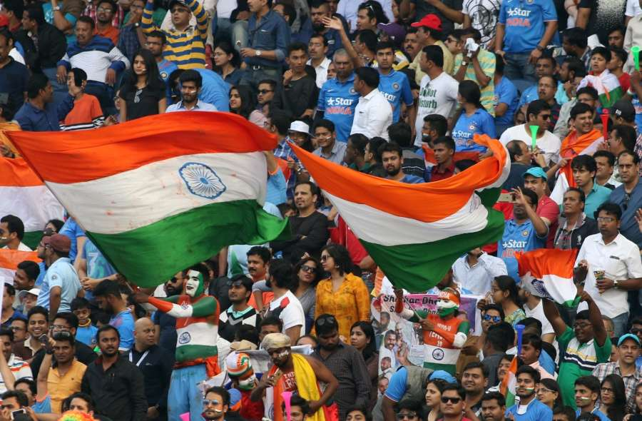 Fans of the Indian cricket team waves the national flag. (Photo: Surjeet Yadav/IANS)