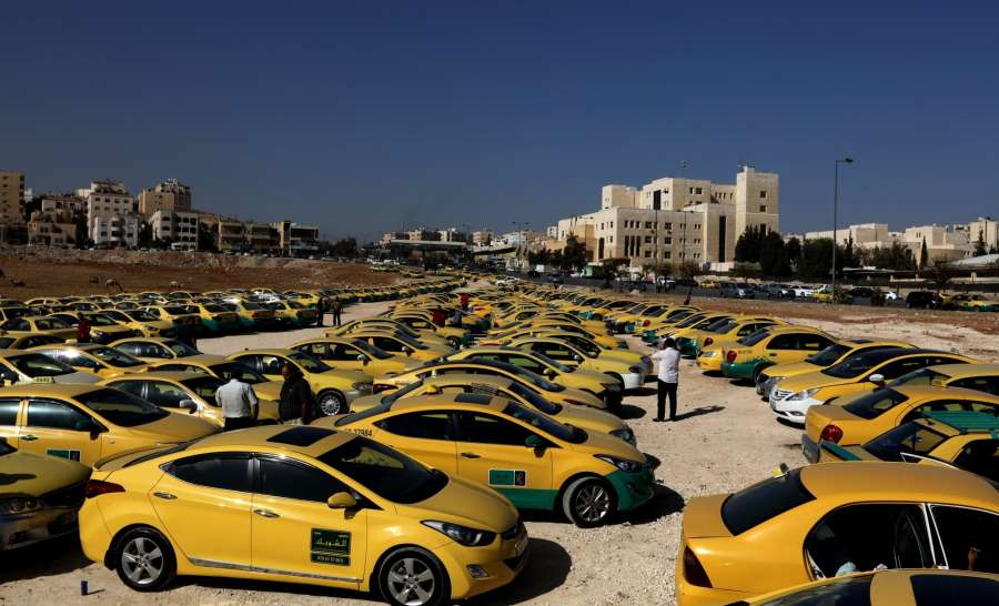 AMMAN, Nov. 15, 2016 (Xinhua) -- A large number of taxi vehicles are seen during a protest by taxi drivers in Tabarbour area, eastern Amman, on Nov. 15, 2016. The taxi drivers protested against the ride sharing service, Uber, which has harmed their daily earnings, and called on the government to meet their demands. The demands include increasing taxi fares, providing taxi drivers with health insurance coverage and registering them as subscribers to the Social Security Corporation (SSC). (Xinhua/Mohammad Abu Ghosh/IANS)