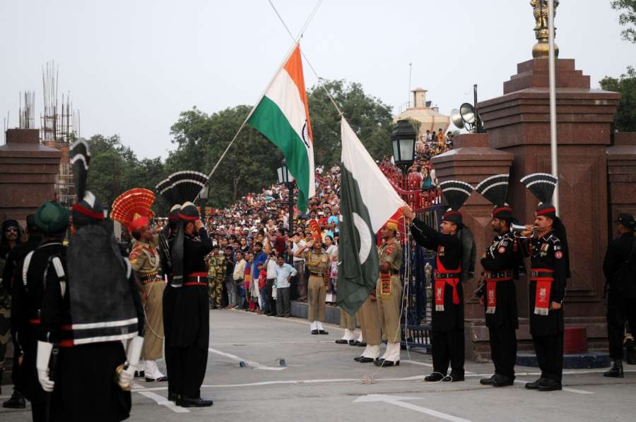 LAHORE, June 26, 2016 (Xinhua) -- Pakistani Rangers (black uniform) and Indian Border Security Force (BSF) personnel perform the flag off ceremony at the Pakistan-India Wagah Border near eastern Pakistan's Lahore on June 25, 2016. (Xinhua/Ahmad Kamal/IANS) by .