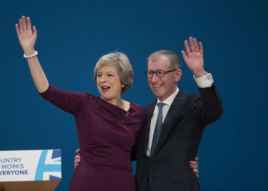 BIRMINGHAM, Oct. 5, 2016 (Xinhua) -- British Prime Minister Theresa May (L) and her husband Philip greet the audience after her speech on the final day of the Conservative Party Conference in Birmingham, Britain, on Oct. 5, 2016. British Prime Minister Theresa May closed the Conservative's annual conference in Birmingham Wednesday, saying her party is to occupy the center ground in politics. (Xinhua/IANS) by .