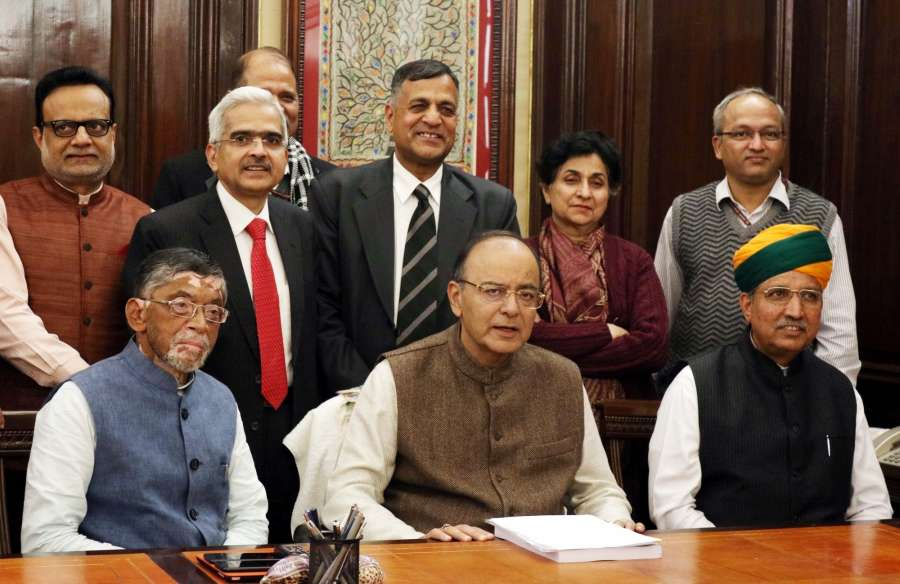 New Delhi: Union Minister for Finance and Corporate Affairs Arun Jaitley gives final touches to the Union Budget 2017-18, in New Delhi on Jan 31, 2017. Also seen Minister of State for Finance and Corporate Affairs Arjun Ram Meghwal, the Minister of State for Finance Santosh Kumar Gangwar, the Secretaries of the Ministry along with the full budget team. (Photo: IANS) by .
