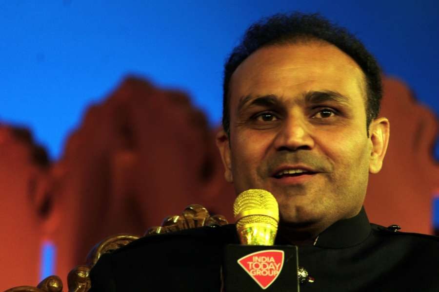 "New Delhi: Former Indian cricketer Virender Sehwag addresses at ""Agenda Aaj Tak"" in New Delhi on Dec 7, 2016. (Photo: IANS) by ."