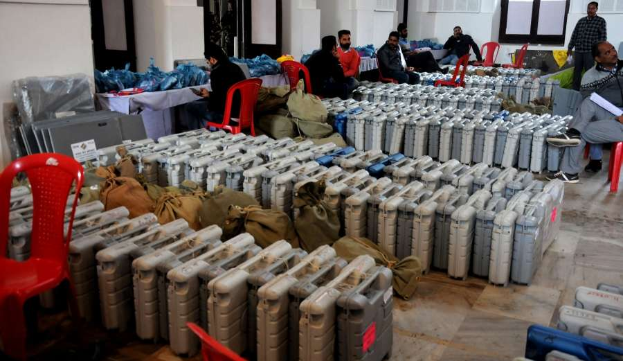 Amritsar: Poll personnel collect Electronic Voting Machines before leaving for their respective booths on the eve of Punjab Assembly Polls in Amritsar on Feb 3, 2017. (Photo: IANS) by .