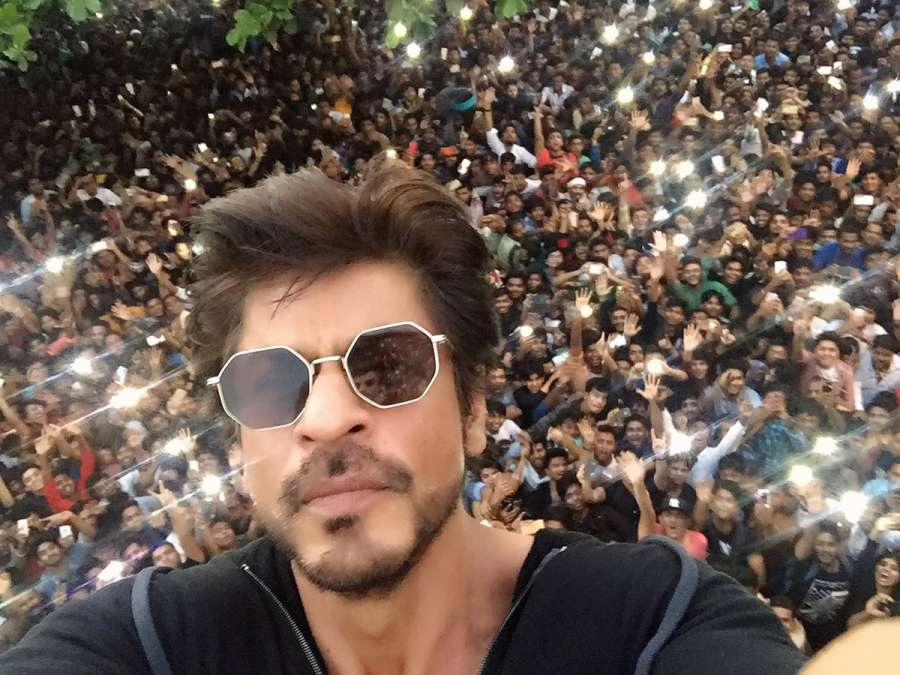 Mumbai: Actor Shahrukh Khan waves as he greets his fans from his bungalow on his 51st birthday in Mumbai, on Nov 2, 2016. (Photo: IANS) by .
