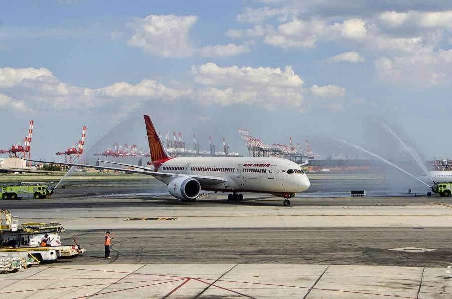 Newark : Air India 787-800 Dreamliner plane being given a ceremonial shower at the Newark airport on Aug. 15, 2016. Air India launches Ahmedabad - Newark direct flight service at Newark Airport on Aug. 15, 2016. (Photo: Mohammed Jaffer/IANS) by .