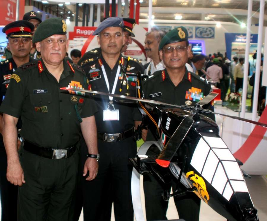 Bengaluru: Army Chief General Bipin Rawat visiting the Army Aviation Pavilion, during the Aero India 2017, at Air Force Station, Yelahanka, in Bengaluru on Feb. 14, 2017.(Photo: IANS/PIB) by .