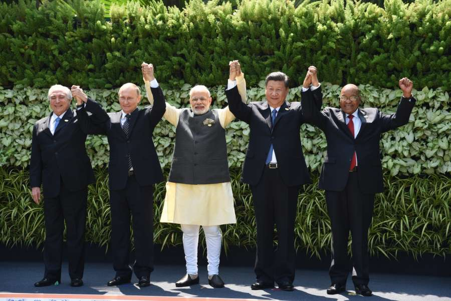 Goa: Prime Minister Narendra Modi, Russian President Vladimir Putin, Chinese President Xi Jinping, South African President Jacob Zuma and Brazilian President Michel Temer during at the BRICS Summit venue, in Goa on Oct 16, 2016. (Photo: IANS) by .