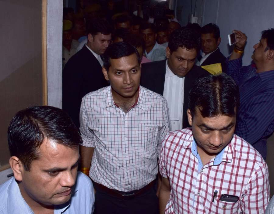 Jaipur : IAS officer Niraj K Pawan being taken to be presented before court after being arrested by Anti-Corruption Bureau in connection with a bribery case in Jaipur, on May 31, 2016. (Photo: Ravi Shankar Vyas/IANS) by .