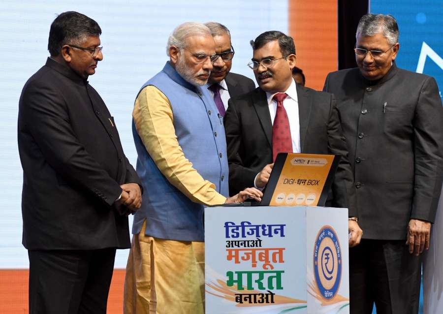 New Delhi: Prime Minister Narendra Modi inaugurates the first weekly draw for Lucky Grahak Yojana and DigiDhan Vyapar Yojana to encourage digital payments during the DigiDhan Mela in New Delhi on Dec 30, 2016. Also seen Union Minister for Electronics & Information Technology and Law & Justice Ravi Shankar Prasad and Minister of State for Electronics & Information Technology and Law & Justice PP Chaudhary. (Photo: IANS) by .