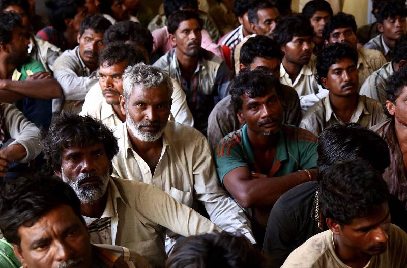KARACHI, March 31, 2016 (Xinhua) -- Arrested Indian fisherman sit at a police station in southern Pakistani port city of Karachi on March 31, 2016. Pakistan's Maritime Security Agency has arrested 59 Indian fishermen and seized ten boats for allegedly fishing in Pakistani waters. (Xinhua/Arshad/IANS) by .