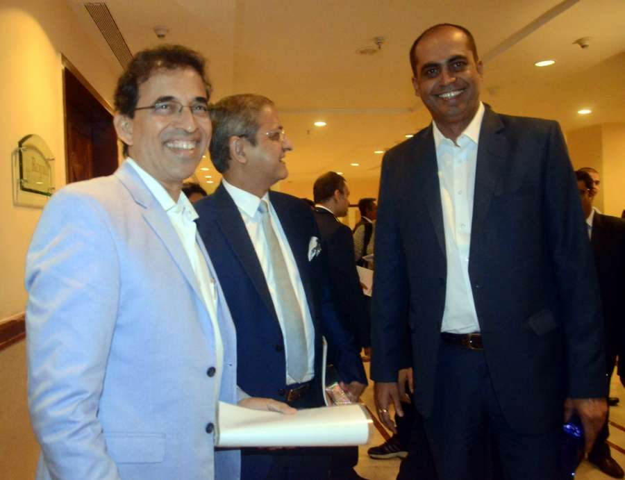 """Mumbai: (L to R) Cricket commentator Harsha Bhogle and former Indian cricketer Nilesh Kulkarni during a summit on """"Business of Sports and Entertainment"""" organised by CII in Mumbai on Sept 21, 2016. (Photo: IANS) by ."""