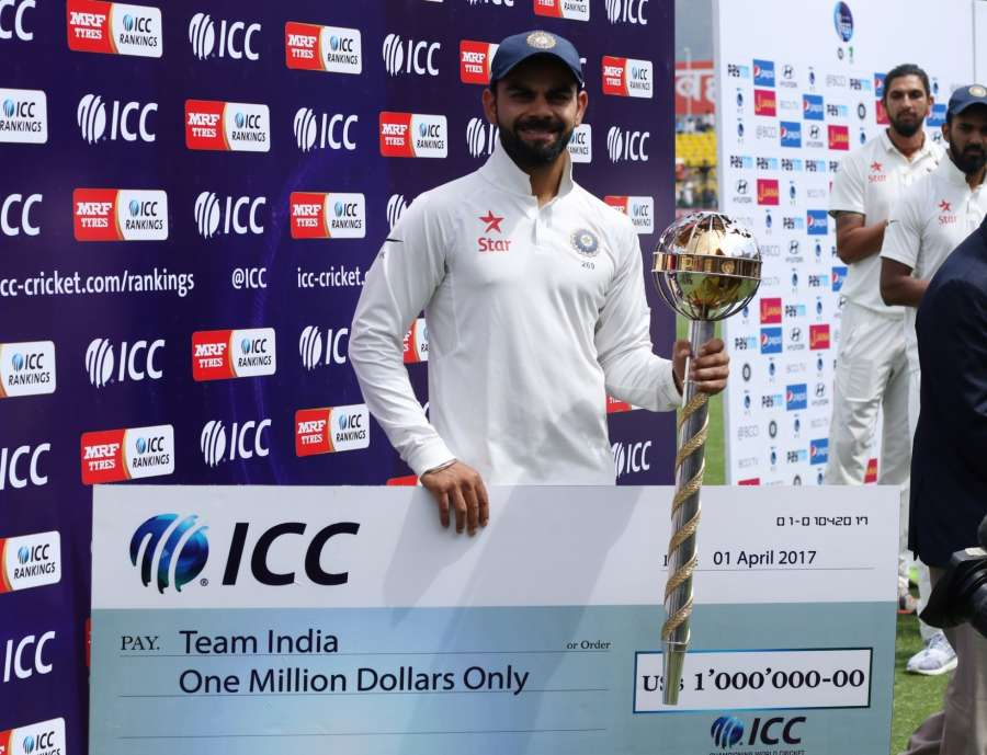Dharamsala: Indian Captain Virat Kohli with the ICC Test Championship mace and cheque at a ceremony after winning the Test match series against Australia at Himachal Pradesh Cricket Association Stadium in Dharamsala on March 28, 2017. Indian cricket team has retained the ICC Test Championship mace and also won a cash award of USD one million for holding on to the top position in the Test Team rankings on the annual April 1 cut-off date. (Photo: Surjeet Yadav/IANS) by .