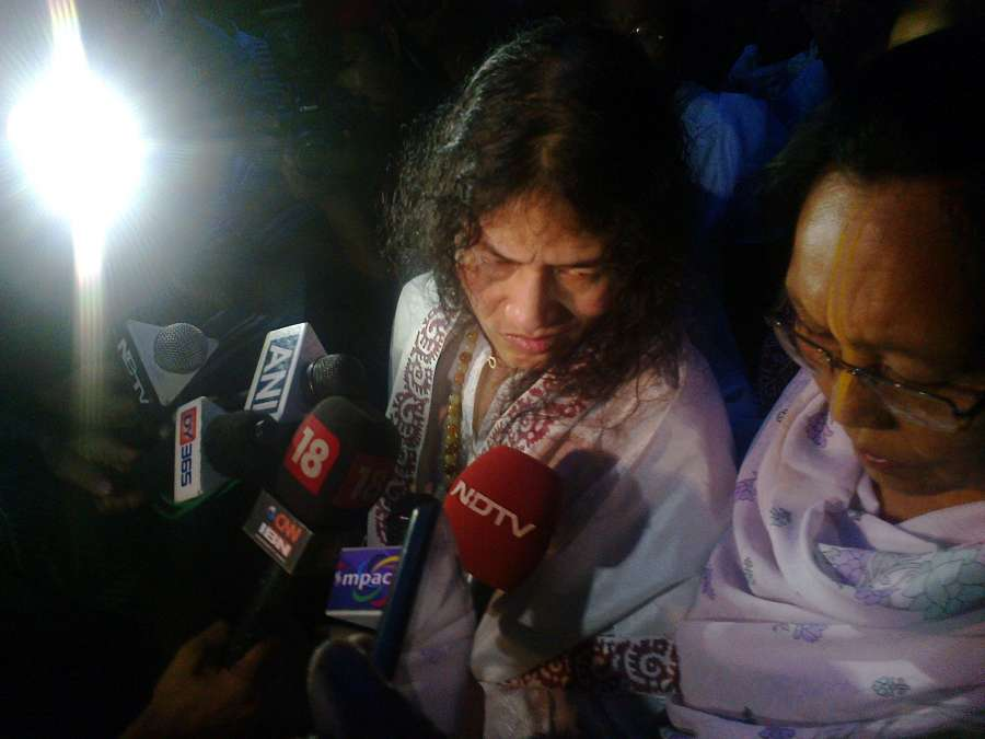 """Irom Sharmila talks to the media as she walks free after being released from hospital in Imphal on Aug 20, 2014. Sharmila, 42, better known as the """"Iron Lady"""", has been on an indefinite fast since Nov 4, 2000, demanding repeal of the Armed Forces (Special Powers) Act, 1958, (AFSPA) after killing of 10 civilians allegedly by the paramilitary Assam Rifles at Malom near Imphal Nov 2, 2000. (Photo: IANS) by ."""