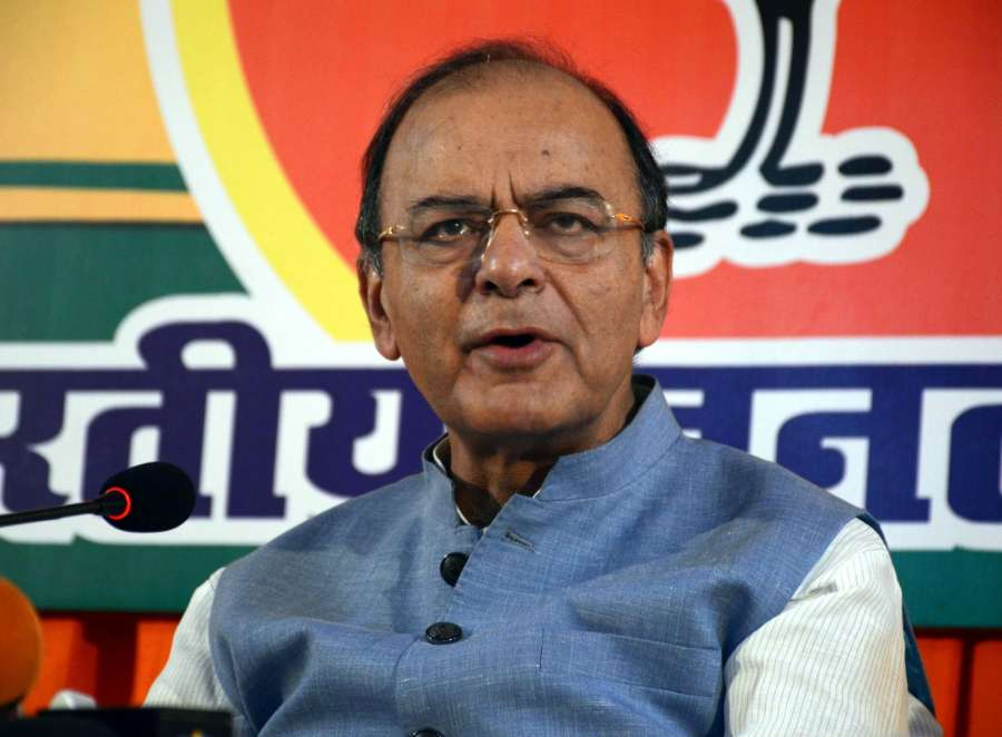 Varanasi: Union Minister for Finance and Corporate Affairs Arun Jaitley addresses a press conference in Varanasi on March 2, 2017. (Photo: IANS) by .