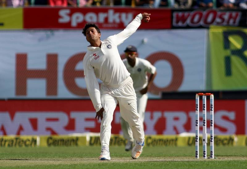 Dharamsala: Kuldeep Yadav of India in action on Day-1 of the fourth Test match between India and Australia at Himachal Pradesh Cricket Association Stadium in Dharamsala on March 25, 2017. (Photo: Surjeet Yadav/IANS) by .