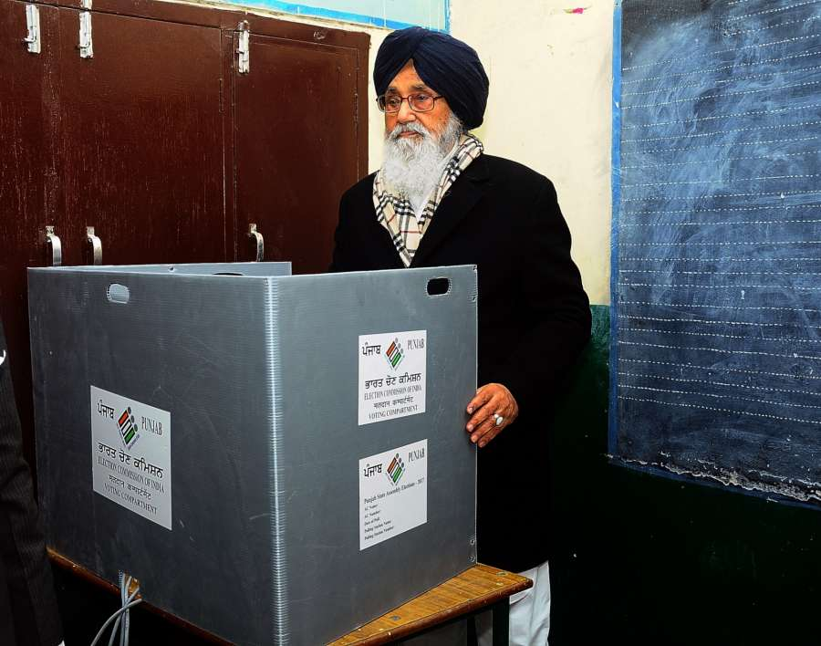 Muktsar: Punjab Chief Minister Parkash Singh Badal casting his vote at a polling booth during Punjab Legislative Assembly polls in Muktsar, on Feb 4, 2017. (Photo: IANS) by .