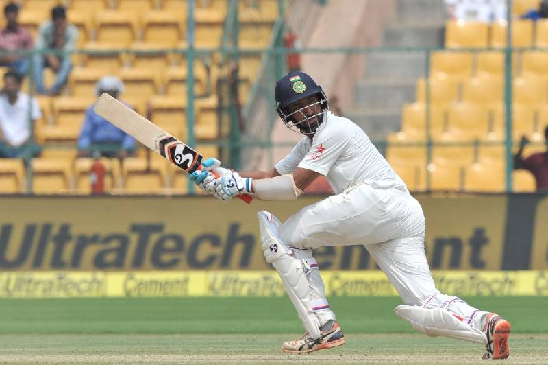 Bengaluru: Cheteshwar Pujara of India in action during the third day of the second test match between India and Australia at M. Chinnaswamy Stadium in Bengaluru on March 6, 2017. (Photo: IANS) by .
