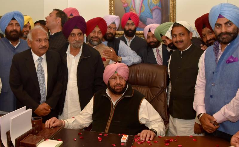 Amritsar: Congress supporters celebrate party's victory in the Punjab assembly elections in Amritsar on March 11, 2017. (Photo: IANS) by .