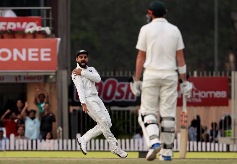 Ranchi: Indian captain Virat Kohli gestures towards Australia's Matt Renshaw as Kohli runs to celebrate the dismissal of David Warner during the fourth day of the third test cricket match in Ranchi on March 19, 2017. (Photo: Surjeet Yadav/IANS) by .