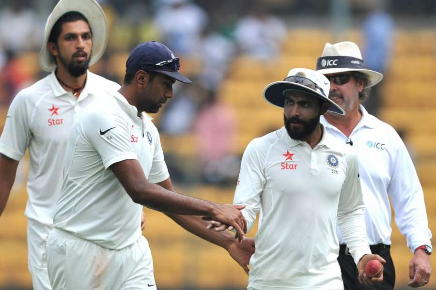 Bengaluru: Indian spinner R Ashwin congratulates Ravindra Jadeja on taking 6 wickets on day three of second test match between India and Australia at M. Chinnaswamy Stadium, in Bengaluru on March 6, 2017. (Photo: IANS) by .