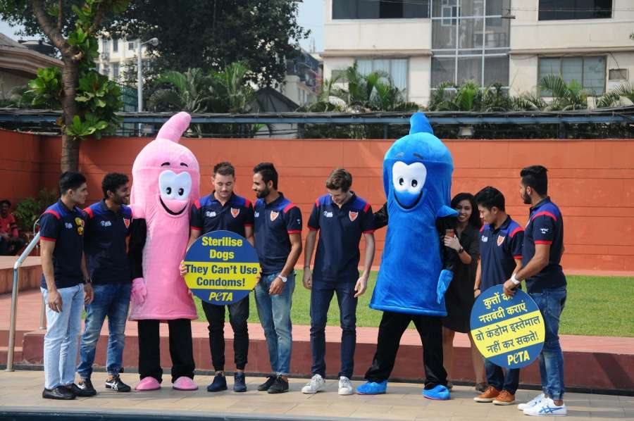 Mumbai: Hockey India League team Dabang Mumbai press for sterilisation of dogs during a PETA programme in Mumbai, on Jan 18, 2017. (Photo: IANS) by .