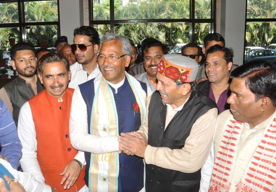 Dehradun: BJP workers greet Trivendra Singh Rawat after his name being announced as candidate for the post of the Chief Minister of Uttarakhand in Dehradun on March 17, 2017. (Photo: IANS) by .