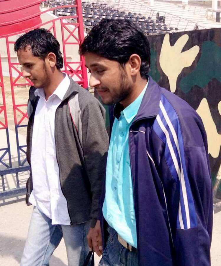 """Attari: Two Pakistani youths Faisal Hussain Awan and Ahsan Khursheed, who were initially suspected to have acted as """"guides"""" for the militants in the terror attack on an Indian Army base in Uri, Jammu and Kashmir being handed over to the Pakistan Army after charges against them could not be proved at the Wagah-Attari border, on March 10, 2017. The two youths, who are reported to be Class 10 students, had run away from home to avoid studies. (Photo: IANS) by ."""