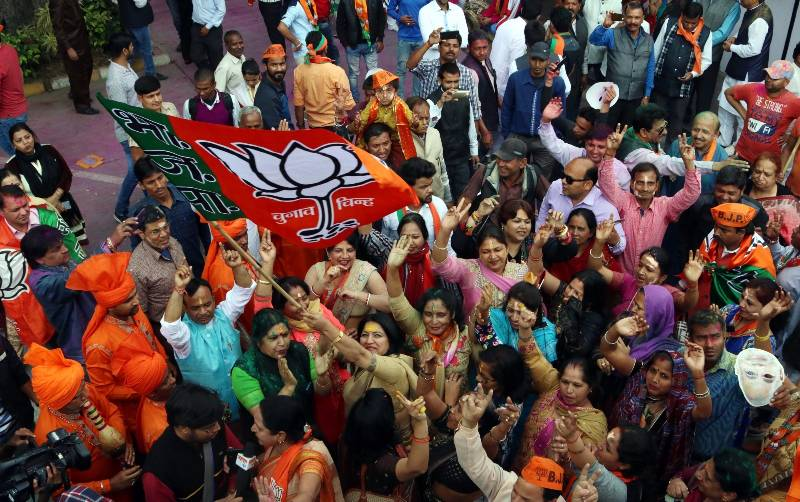 New Delhi: BJP supporters celebrate as assembly election results being announced at BJP office in New Delhi on March 11, 2017. (Photo: IANS) by .