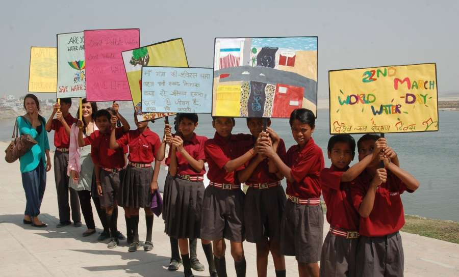 Varanasi: School students holding placards participate in an awareness programme organised on World Water Day on the banks of Ganga river in Varanasi on March 22, 2017. (Photo: IANS) by .
