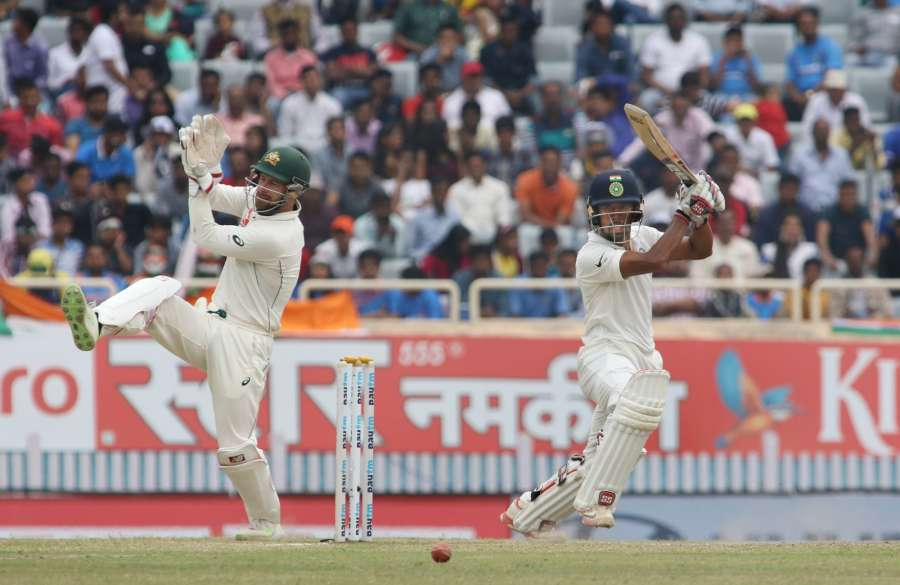 Ranchi: Indian wicket-keeper Wriddhiman Saha playing a shot during the fourth day of the third test cricket match against Australia in Ranchi on March 19, 2017. (Photo: Surjeet Yadav/IANS) by .
