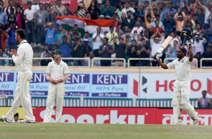 Ranchi: Indian Wicket-keeper Wriddhiman Saha celebrates his century during the fourth day of the third test cricket match against Australia in Ranchi on March 19, 2017. (Photo by Surjeet Yadav/IANS) by .