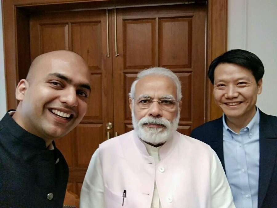 New Delhi: Xiaomi Inc Founder and CEO Lei Jun with Xiaomi India Vice President and MD Manu Jain call on Prime Minister Narendra Modi in New Delhi, on March 28, 2017. (Photo: IANS) by .