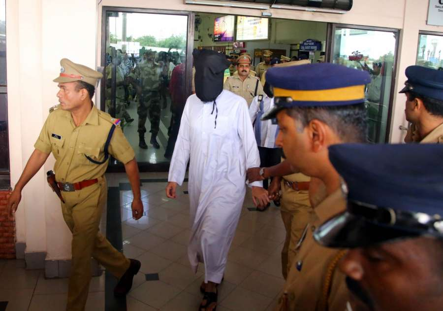 Kochi: Arshi Qureshi and Rizwan Khan, arrested for allegedly recruiting youths to ISIS, have been brought to Kochi International Airport, in Kochi on July 24, 2016. Both of them are associated with controversial Islamic preacher Zakir Naik. (Photo: IANS) by .