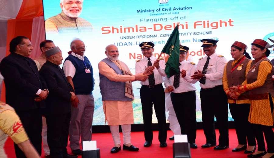 Shimla: Prime Minister Narendra Modi flags-off first Shimla-Delhi flight under UDAN - Ude Desh ka Aam Nagrik scheme at Jubbarhatti airport in Shimla on April 27, 2017. (Photo: IANS) by .