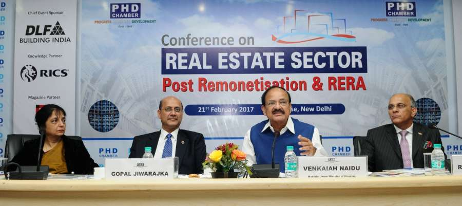 """New Delhi: Union Minister for Urban Development, Housing & Urban Poverty Alleviation and Information & Broadcasting M Venkaiah Naidu addresses during a conference on """"Real Estate Sector Post Remonetisation and RERA"""" in New Delhi on Feb 21, 2017. Also seen Secretary, Ministry of Housing and Urban Poverty Alleviation (HUPA), Dr. Nandita Chatterjee and other dignitaries. (Photo: IANS/PIB) by ."""