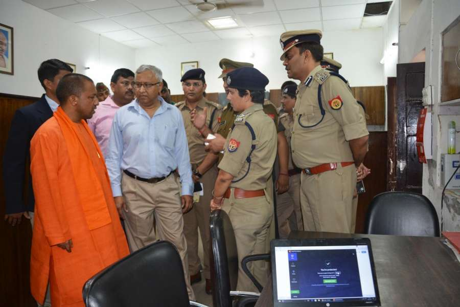 Lucknow: Uttar Pradesh Chief Minister Yogi Adityanath during his surprise visit to Hazratganj police station in Lucknow on March 23, 2017. (Photo: IANS) by .