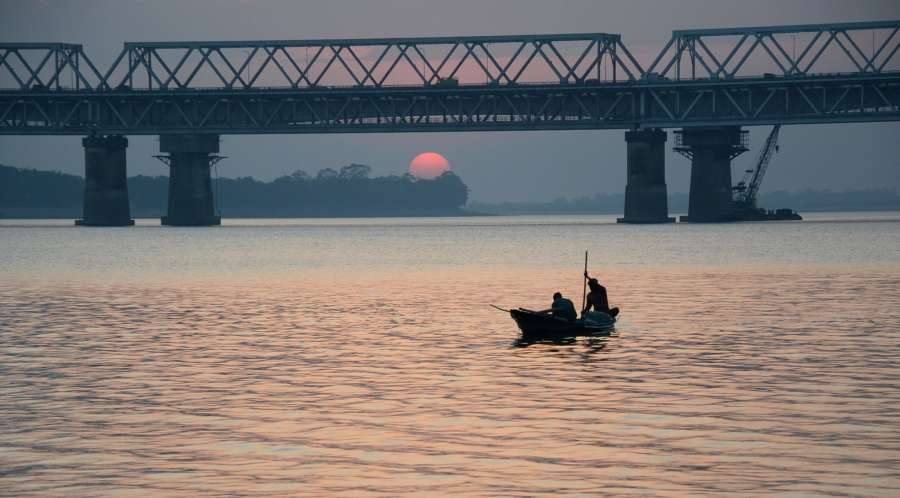 Guwahati: Fishermen return home at sunset after a day of fishing on the banks of Brahmaputra River in Guwahati on Dec 30, 2016. (Photo: IANS) by .