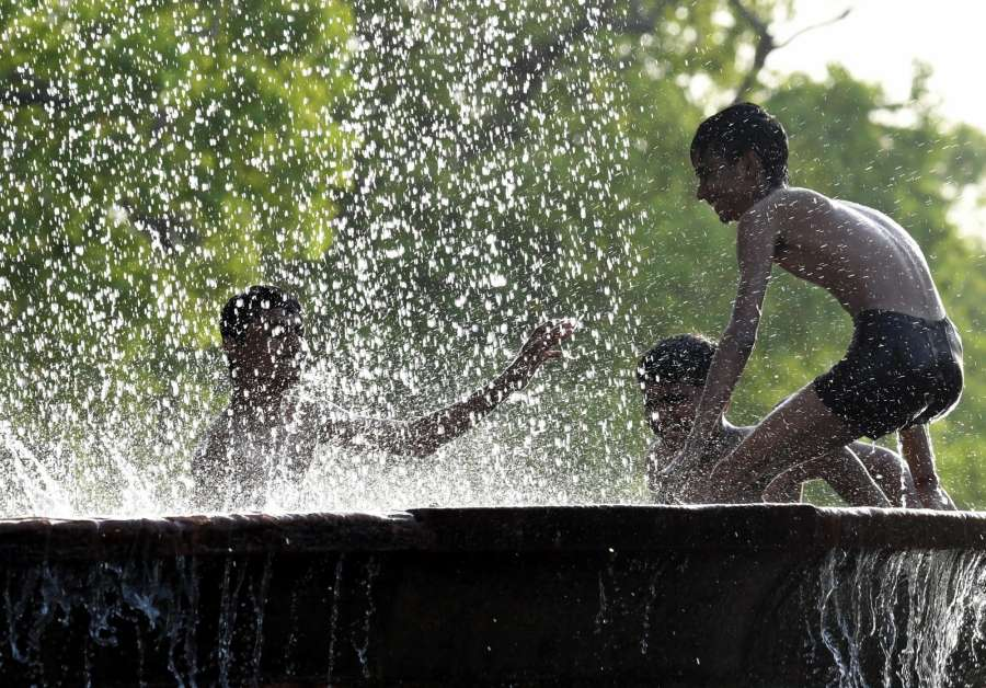 New Delhi: Children beat the heat on a hot day in New Delhi on April 20, 2017. (Photo: IANS) by .