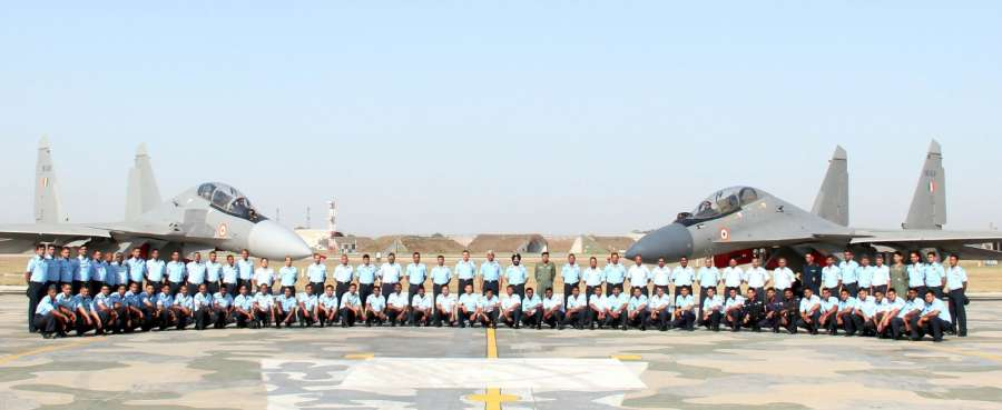"""Halwara: The Air Officer Commanding-in-Chief Western Air Command, Air Marshal C Hari Kumar with the Squadron personnel of """"THE VALIANTS"""" during the induction ceremony of Sukhoi Su-30MKI, at Air Force Station, Halwara (Punjab) on April 24, 2017. (Photo: IANS/PIB) by ."""