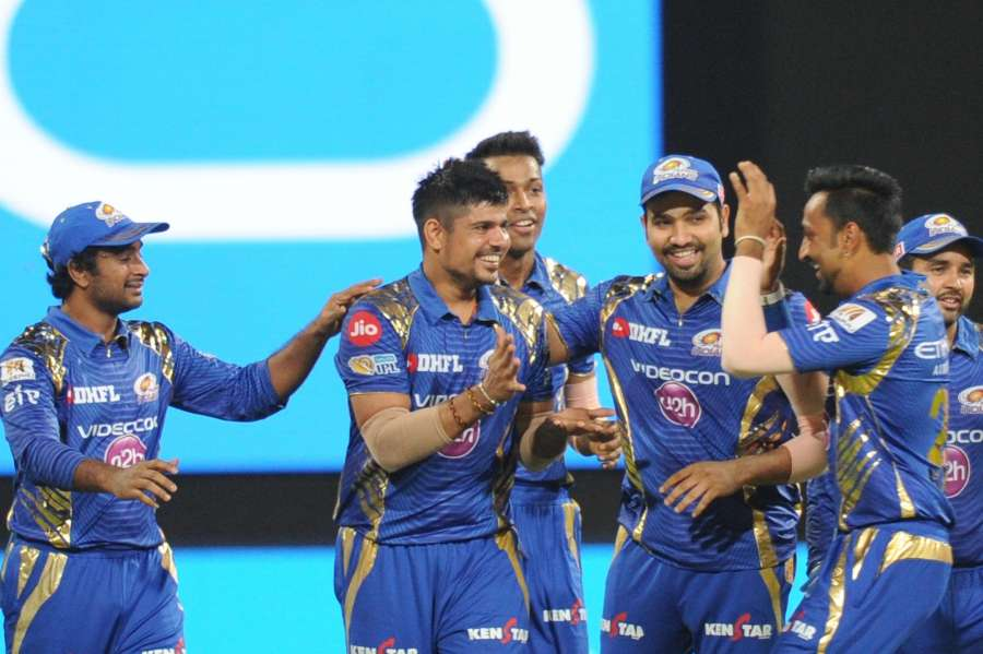 Bengaluru: Mumbai Indians celebrate fall of a wicket during Qualifier 2 of IPL 2017 between Mumbai Indians and Kolkata Knight Riders at M Chinnaswamy Stadium in Bengaluru on May 19, 2017. (Photo: Dhananjay TK/IANS) by .