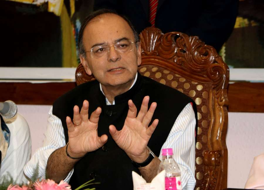 Srinagar: Union Finance Minister Arun Jaitley addresses a press conference after the first day of the GST Council meet.at Sher-e-Kashmir International Convention Centre (SKICC) in Srinagar on May 18, 2017. (Photo: IANS) by .