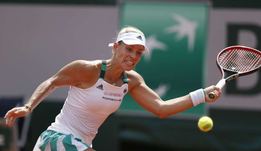 PARIS, May 28, 2017 (Xinhua) -- Angelique Kerber of Germany returns a shot during the women's singles first round match with Ekaterina Makarova of Russia at French Open Tennis Tournament 2017 in Roland Garros, Paris, France on May 28, 2017. (Xinhua/Han Yan/IANS) by .