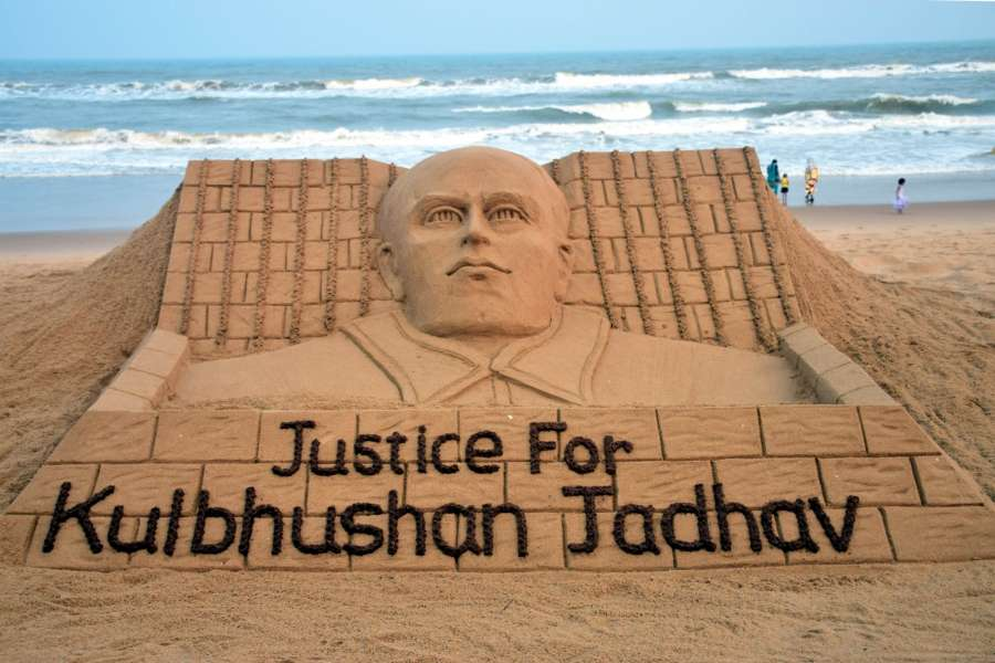 """Puri: Renowned sand artist Sudarsan Pattnaik's creation to press for """"Justice for Kulbhushan Jadhav"""" in Puri on May 15, 2017. (Photo: IANS) by ."""