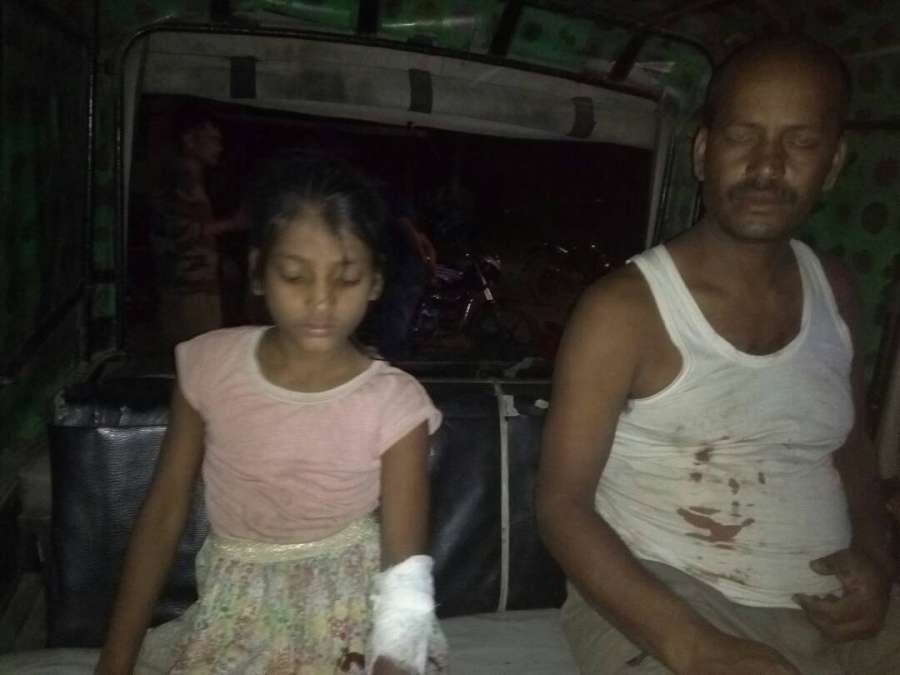 Tinsukia: Yogendra Pratap Singh and his minor daughter who were injured after suspected militants hurled a grenade at their residence in Tinsukia district of Assam on May 4, 2017. (Photo: IANS) by .